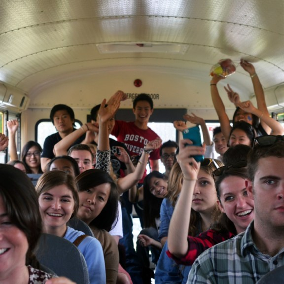 Students cheer on the bus ride home after a fun day of apple picking!