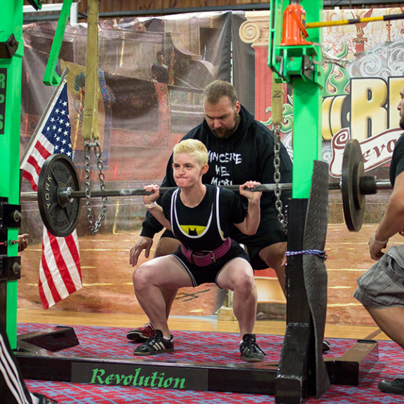 During the squats, three spotters and chains are there to catch the bar in case you drop it.
