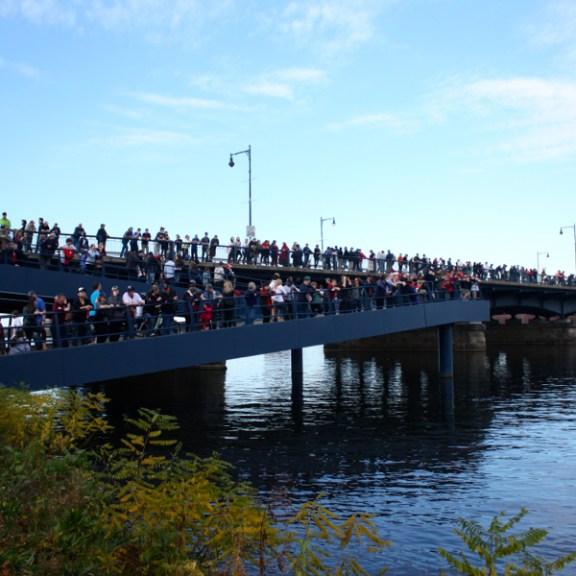 Spectators lined the Esplanade and the Mass Ave. Bridge