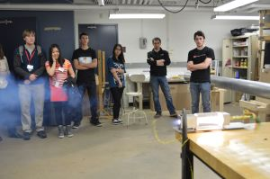 The group fires a small, acrylic rocket motor in their lab as a demonstration to a tour of admitted students. Photo by Jake Lucas