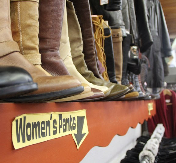 The boot display at Rerun features a wide variety of brands, colors, and styles of shoes for sale.