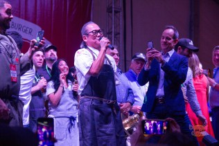 Morimoto serenades the crowd after this victory.