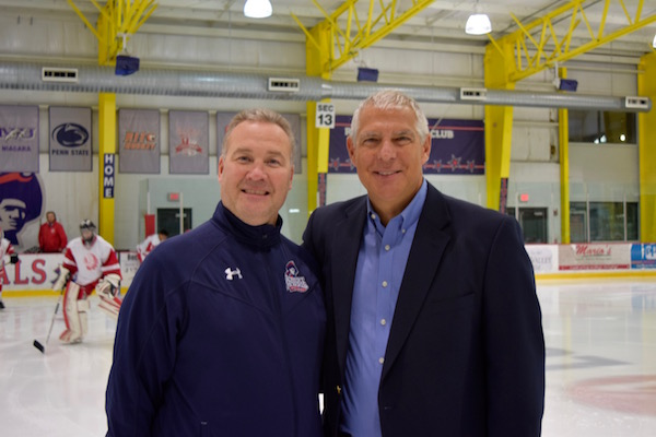 Robert Morris head coach Derek Schooley poses for a photo with PIHL commissioner Craig Barnett.