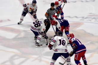Tomahawks and Rebels line up for the opening faceoff.