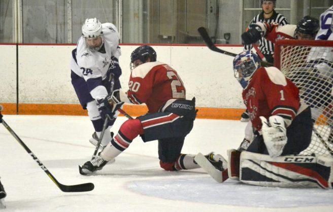 Timmy Moore blocks the shot of Niagara forward Ben Sokay. -- ALAN SAUNDERS