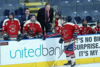January 26,2018; Springfield, Massachusetts, United States; Robert Morris Colonials forward Michael Louria (7) gets instructions from Robert Morris Colonials head coach Derek Schooley during a conference matchup between Robert Morris and AIC won by the Yellow Jackets 3-1 at the MassMutual Center. Photo: Brian Foley-Foley Photography.