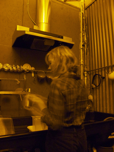 Dowda developing film in the darkroom at The Goat Farm Arts Center