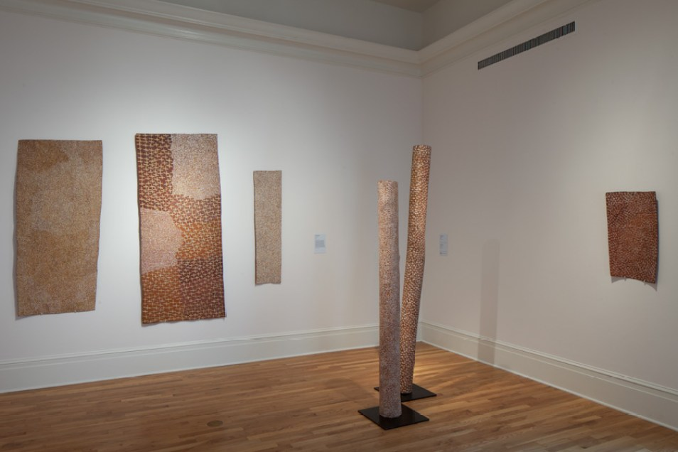 Installation view showing works by Yunupingu.
