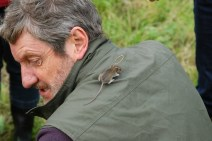 One that almost got away. A mouse escaped from Alan and ran up his arm and onto his back.