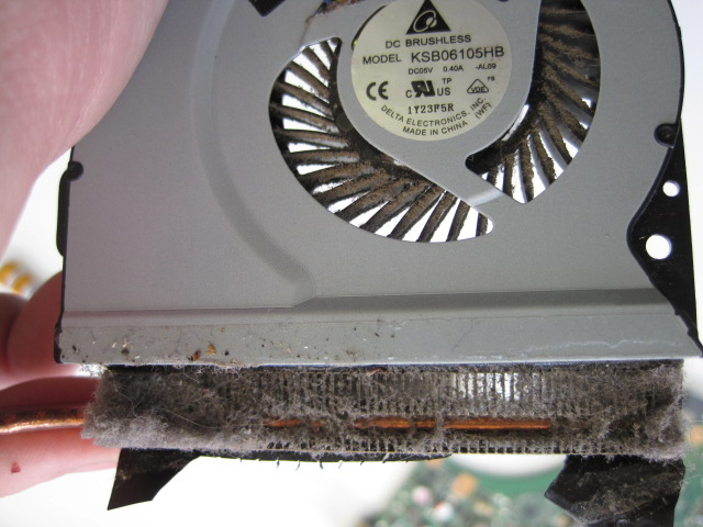 Clean the visible dust and then undo the 4 screws holding the top cover to the fan.