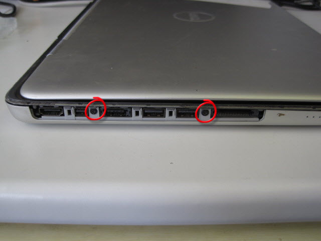 Remove the two hidden screws behind the panel.