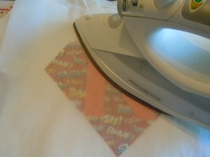 Ironing on to the T-shirt (parchment paper between the fabric & the iron)