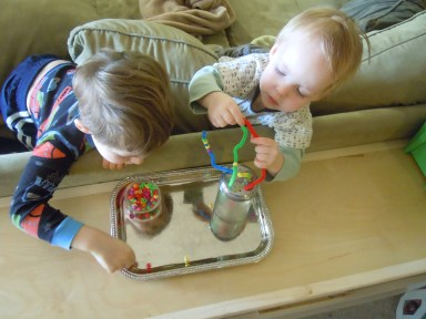 The boys using the fine- motor activity
