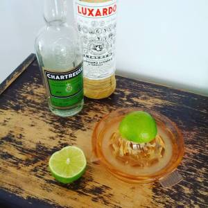 Juicing limes to make a cocktail called The Last Word