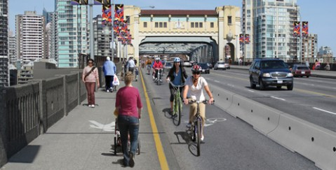 A rendering of the Burrard Bridge bike lane trial, which starts on Monday. Photo from the <a href=http://vancouver.ca/projects/burrard/index.htm>City of Vancouver</a>.