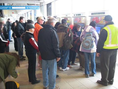 Crowds using the ticket machines at Bridgeport Station.