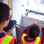 Campers rode a SkyTrain in the yard and got to see the manual control panel!