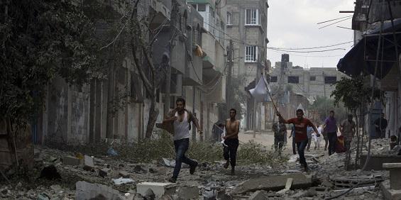 Palestinians Running Through a Street