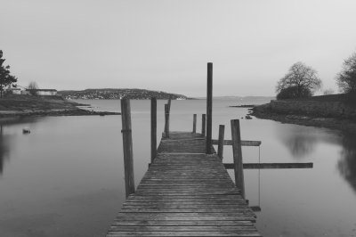 grayscale photo of dock on body of water free image | Peakpx