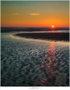 zonsopkomst met reflecties