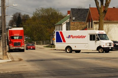 Purolator courier delivery van and red International day c… | Flickr
