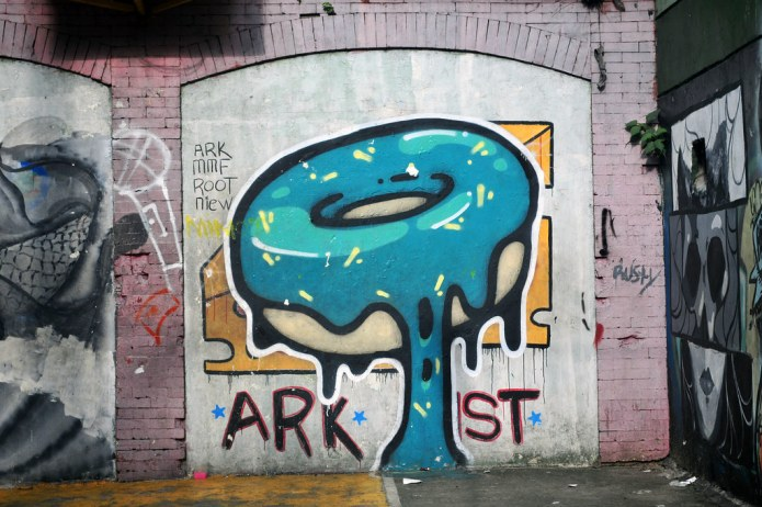 graffiti in public housing yard with makeshift basketball court 4