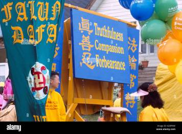 Falun Gong aka Falun Dafa Practitioners marching in Peaceful Parade, Vancouver, BC, British Columbia, Canada Stock Photo