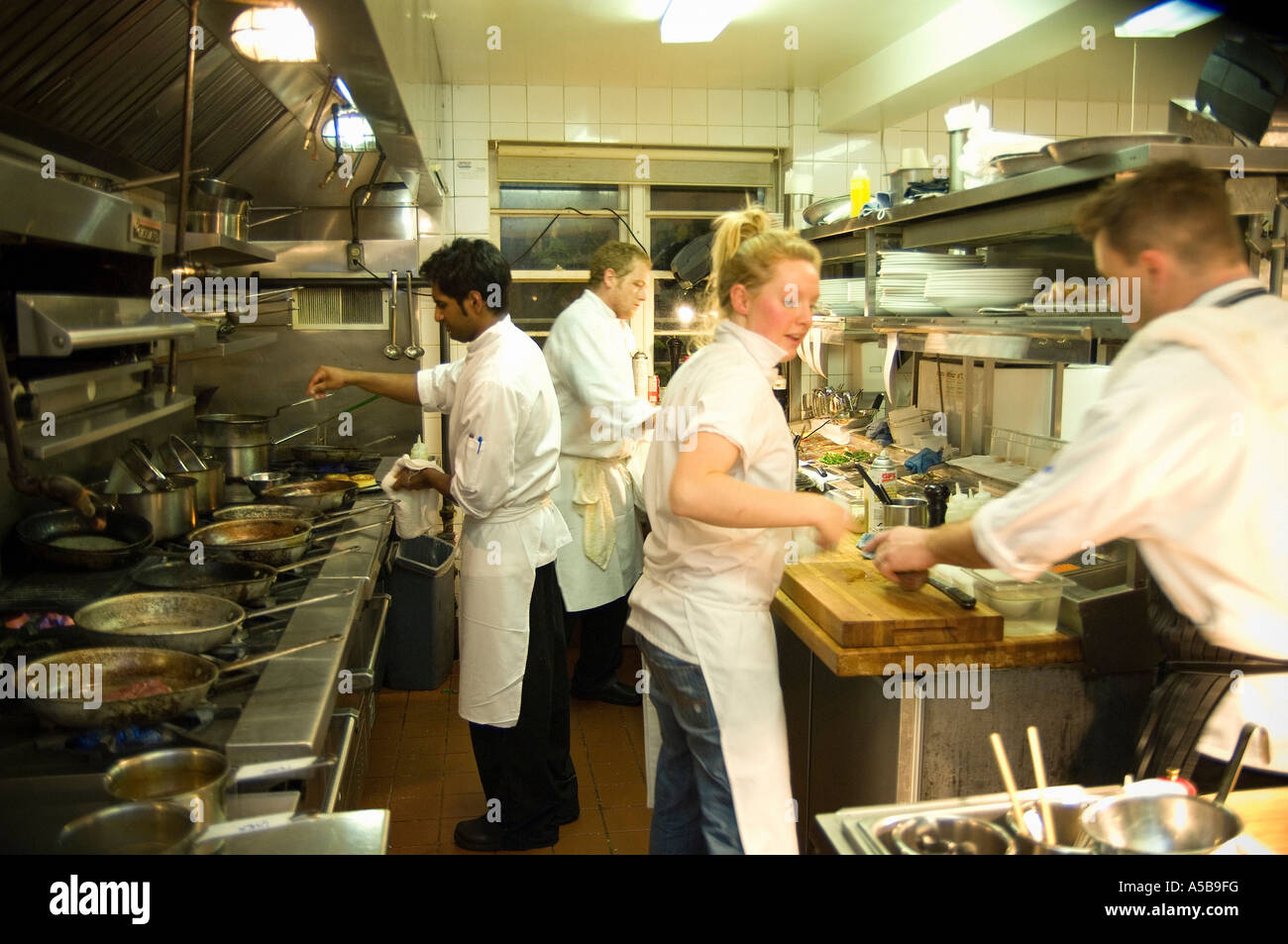 Busy Restaurant Kitchen fine busy restaurant kitchen team of staff in decorating - miaowan.co