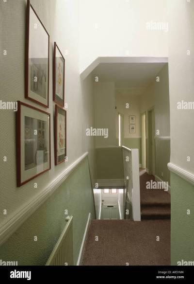 Pastel wallpaper below white dado rail on townhouse landing with Stock Photo, Royalty Free Image ...