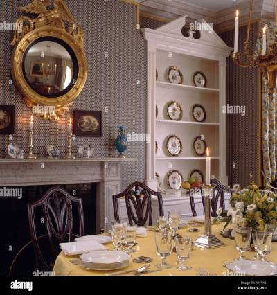 Diningroom with grey striped wallpaper and gilt mirror over fireplace Stock Photo, Royalty Free ...