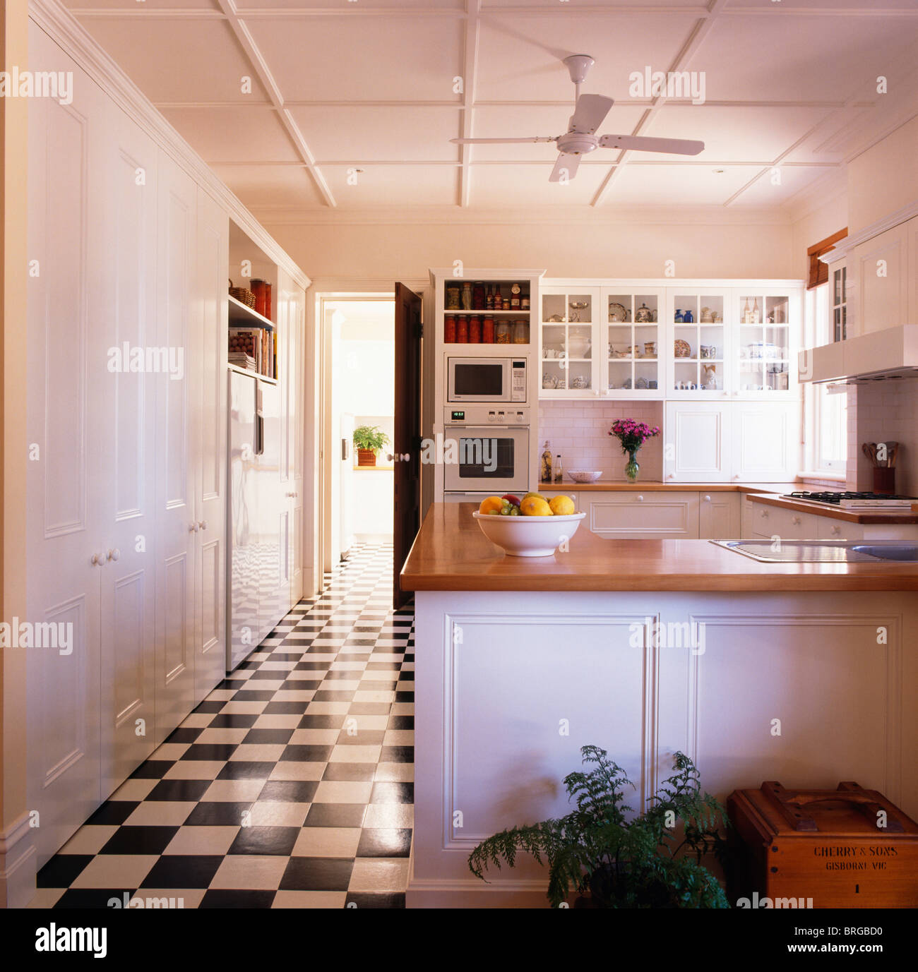 stock photo blackwhite checkerboard vinyl flooring in large modern white kitchen vinyl flooring kitchen Black white checkerboard vinyl flooring in large modern white kitchen with wooden worktops on fitted units