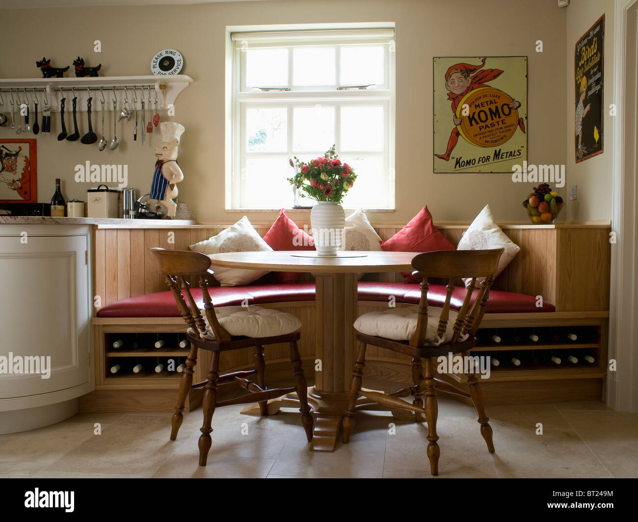 circular table and old wooden chairs in kitchen dining room with fitted BT249M