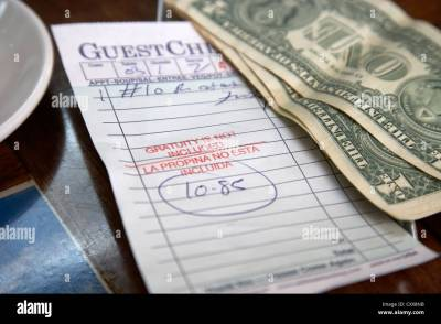 guest check with gratuity not included notice with cash and tip in a Stock Photo, Royalty Free ...