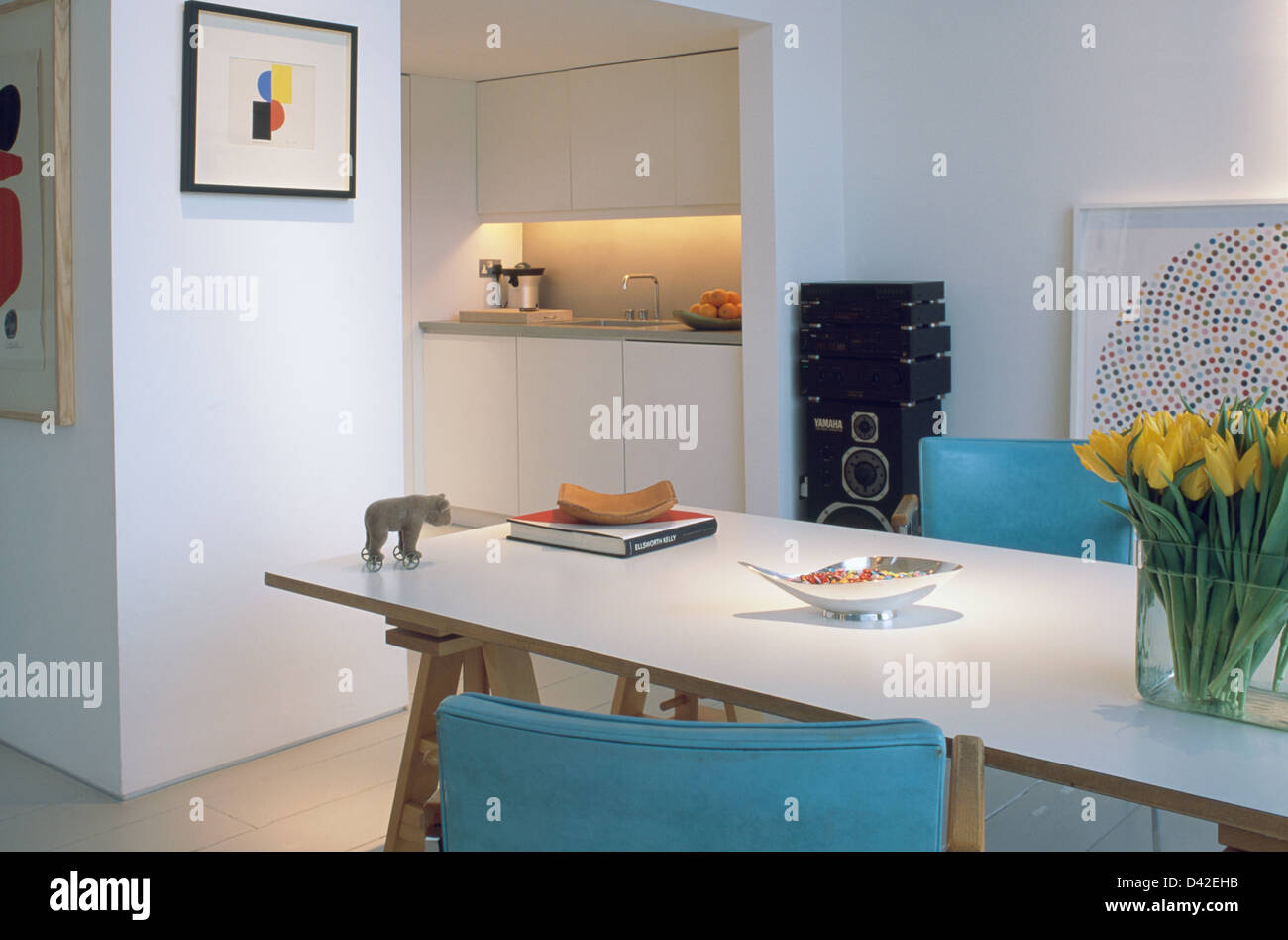 turquoise chairs at white trestle table in loft conversion dining D42EHB