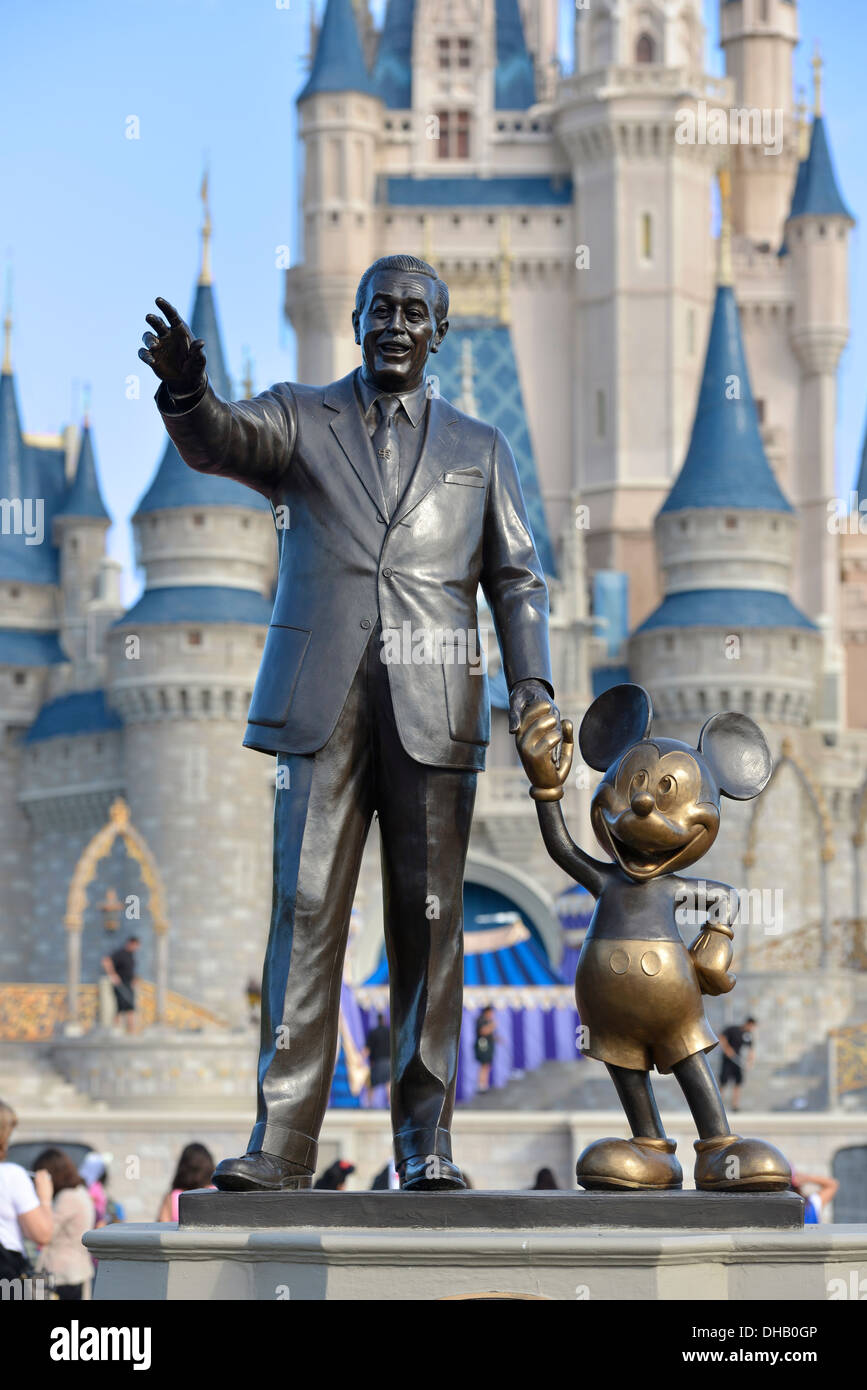 Walt Disney and Mickey Mouse Statue in front of Cinderella Castle at     Walt Disney and Mickey Mouse Statue in front of Cinderella Castle at Magic  Kingdom  Disney World Resort  Orlando Florida