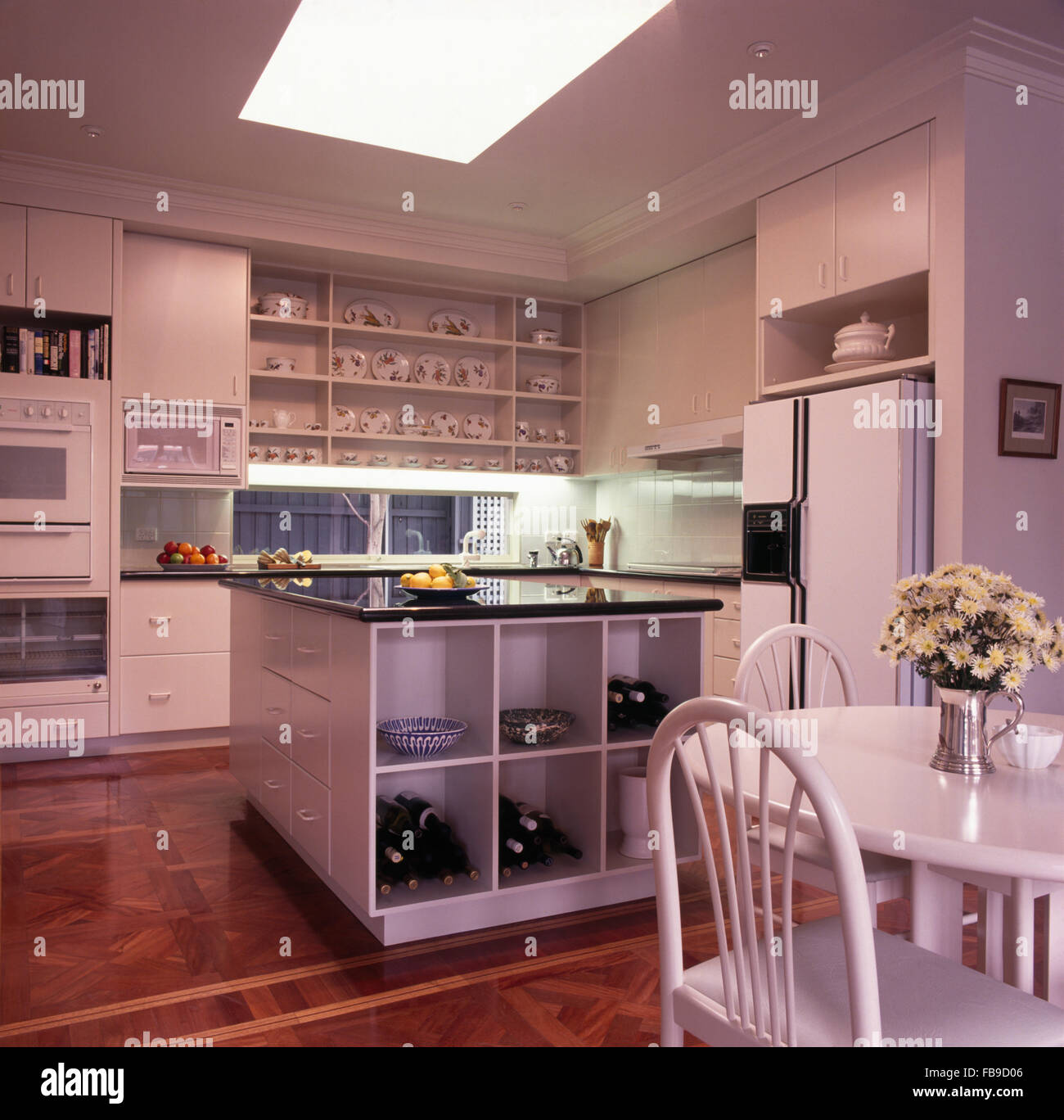 white dining table and chairs and an american style fridge freezer FB9D06