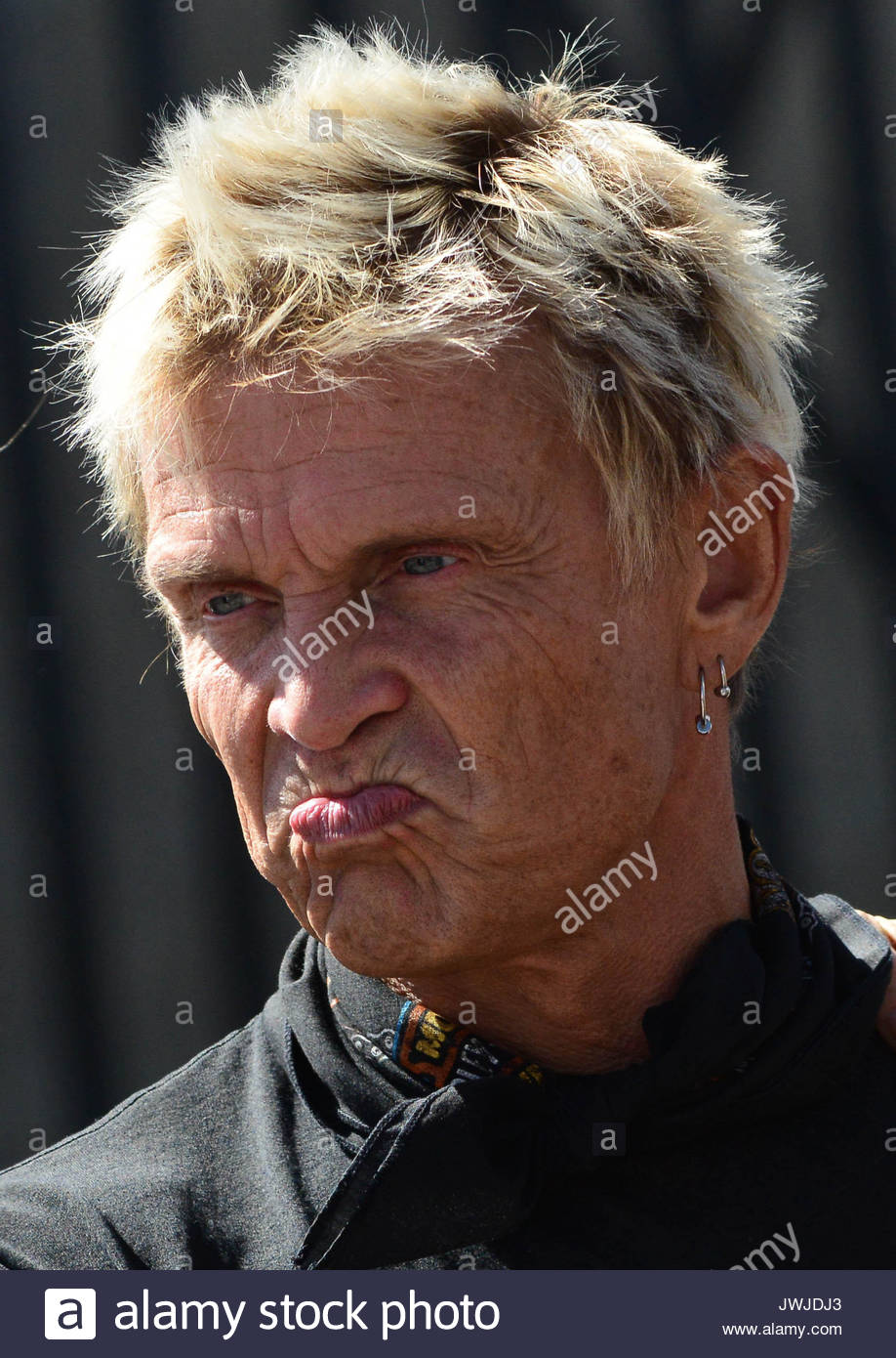 Billy Idol  Rocker Billy Idol spit gels his spiked hair while Stock     Billy Idol  Rocker Billy Idol spit gels his spiked hair while visiting  friends on the set of  CSI Crime Scene Investigation  at Arena Nightclub in  West