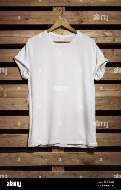 Blank white t-shirt hanging on the wooden background, with copy space Stock Photo: 218385107 - Alamy