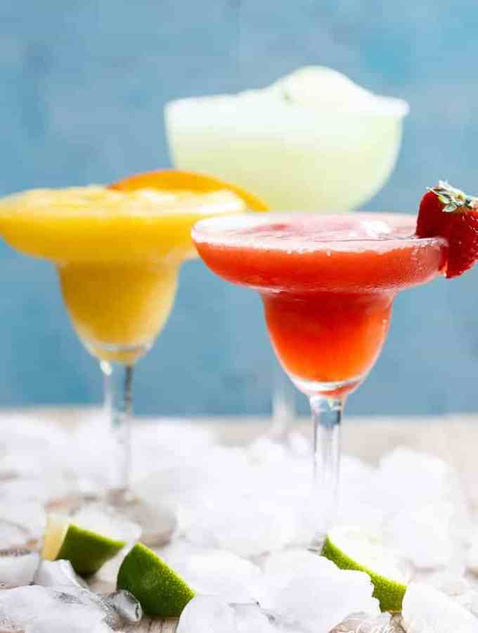 Frozen Strawberry and Mango Margaritas are refreshing and fruity and even better than the original Margarita! Celebrate in style! | http://cafedelites.com
