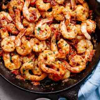 Spicy and garlicky with the subtle sweetness of sun dried tomatoes, this Spicy Garlic Sun Dried Tomato Shrimp takes less than 10 minutes! | http://cafedelites.com