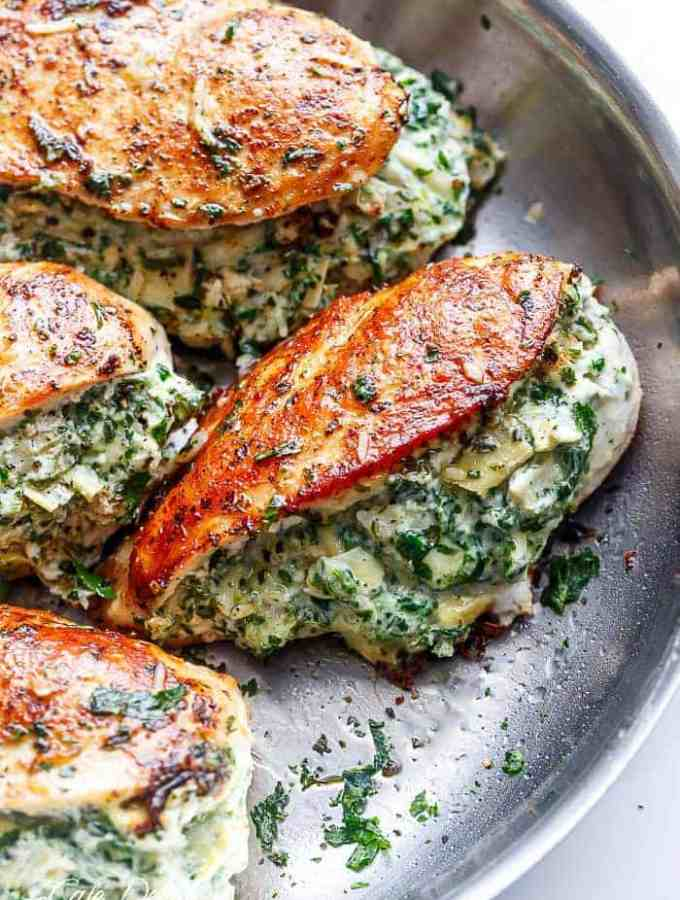 Spinach Artichoke Stuffed Chicken is a delicious way to turn a creamy dip into an incredible dinner! Serve it with a creamy sauce for added flavour!   http://cafedelites.com