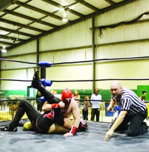 The weather was something of a problem Saturday, but the rest of the weekend saw large and enthused crowds taking in the 2016 edition of Brampton Fall Fair. Captain Tremendous employed an airplane spin, followed by a splash from the lower ropes to get the count from referee Brad Meyers for victory over Toro Asiaro last Thursday night at Brampton Fall Fair. Classic Championship Wrestling was providing the entertainment on the first night of a very busy weekend at the Fair. Photo by Bill Rea