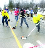 """The weather last Saturday was unseasonably warm, putting a damper on the annual Alton Mill Pond Hockey Classic. But organizers were ready with Plan B, and players left the pond to take part in the grand Canadian custom of street hockey. """"We had to roll with what came,"""" Alton Mill co-proprietor Jeremy Grant observed. Councillor Johanna Downey was sent on a break away by Inspector Ryan Carothers of Caledon OPP. Photos by Bill Rea"""