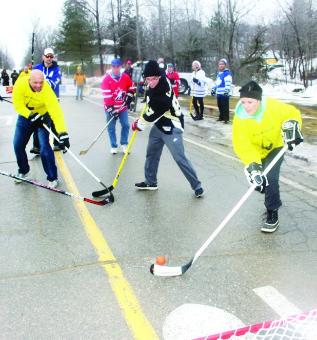 "The weather last Saturday was unseasonably warm, putting a damper on the annual Alton Mill Pond Hockey Classic. But organizers were ready with Plan B, and players left the pond to take part in the grand Canadian custom of street hockey. ""We had to roll with what came,"" Alton Mill co-proprietor Jeremy Grant observed. Councillor Johanna Downey was sent on a break away by Inspector Ryan Carothers of Caledon OPP. Photos by Bill Rea"