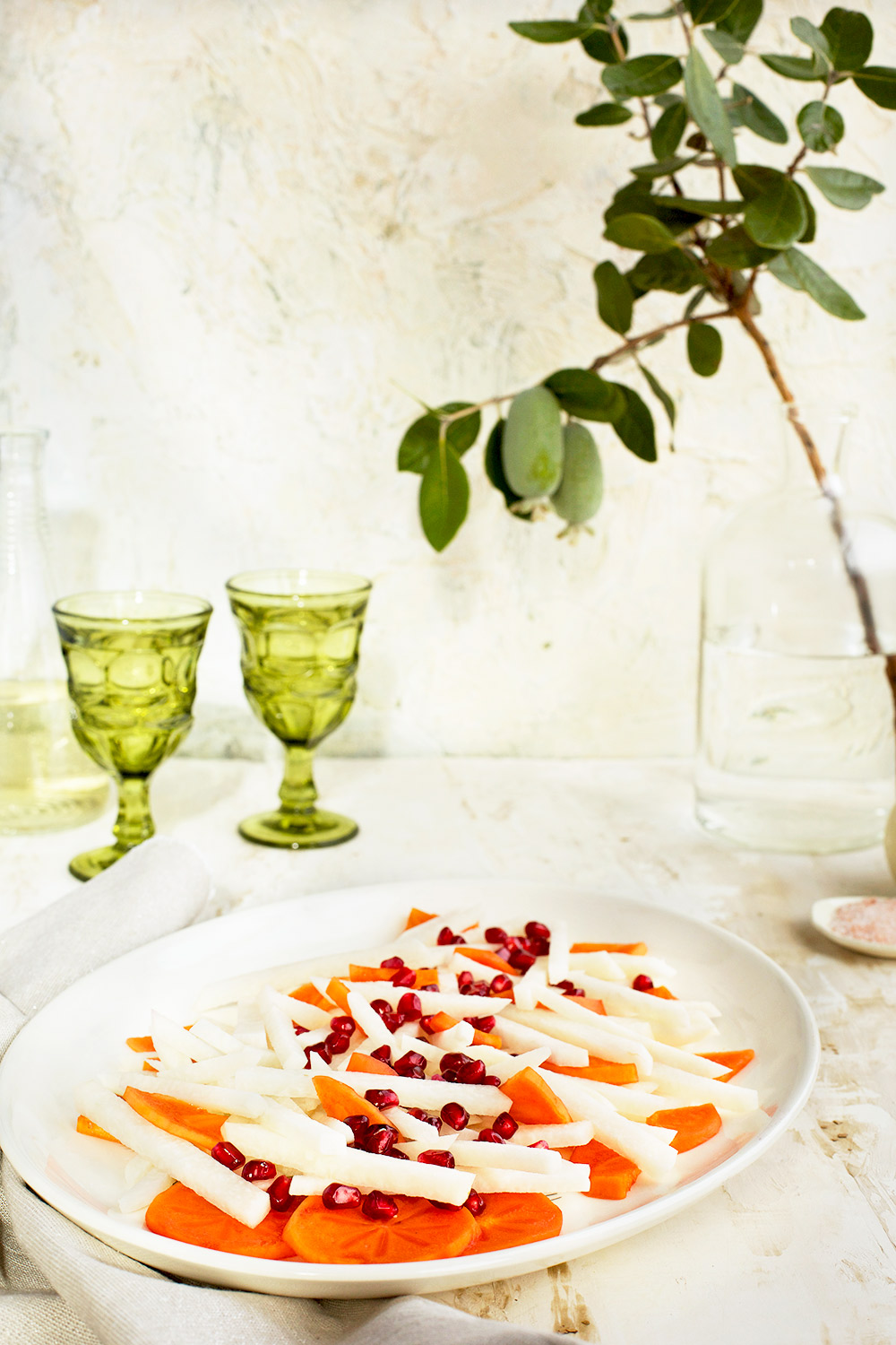 Jicama Persimmon Pomegranate Salad with Guava Chevre Vinaigrette - #gluten free - CaliZona There is a lot of texture going on in this dish. The guava chevre vinaigrette has a wonderful creaminess with a unique floral quality from the guavas.