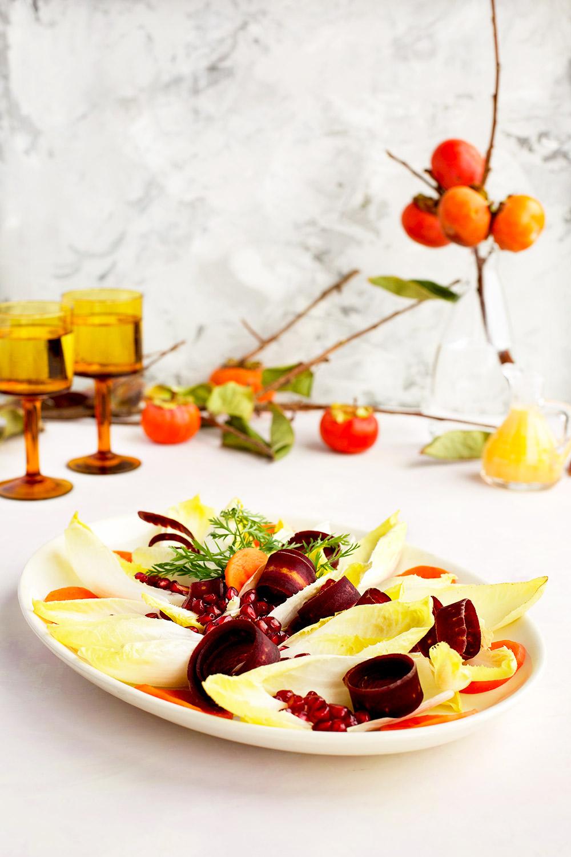 Endive Pomegranate Salad is a festive gluten free salad with a wonderful persimmon chevre vinaigrette.