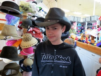 Our cowboy in the hat store