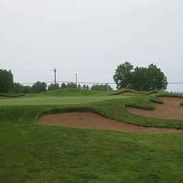 The 15th green, with its bunkers recently restored.