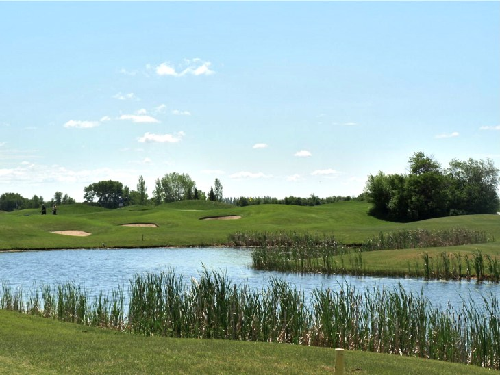 View from 150 yards out, across the pond on the great starting hole number 1 of the Highlands
