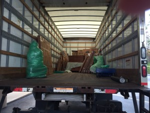 This is the first load from Middelburg with all our 'precious' items. This 10' by 10' load looks tiny in the big moving truck. The green bubble wrapped item is a gorgeous carved Buddha.